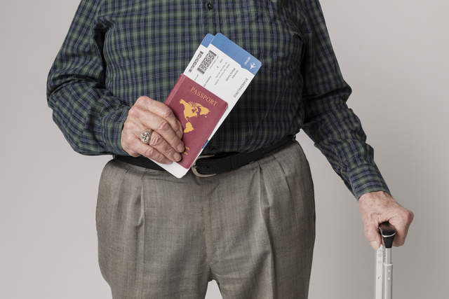 man traveling with his passport